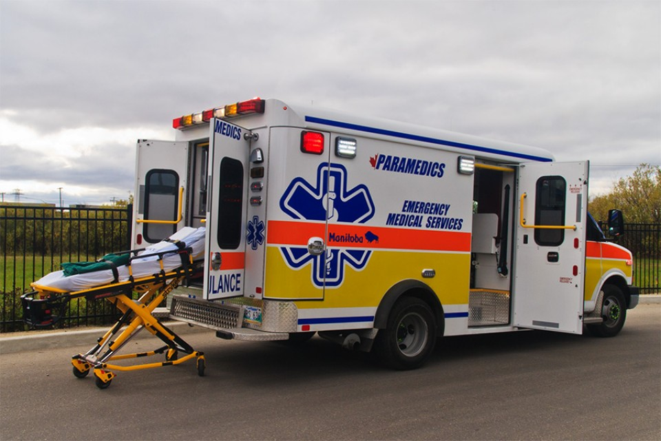 Ambulance viewed from side with stretcher extended